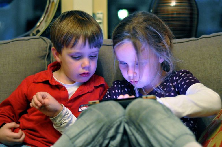 Children using an iPad
