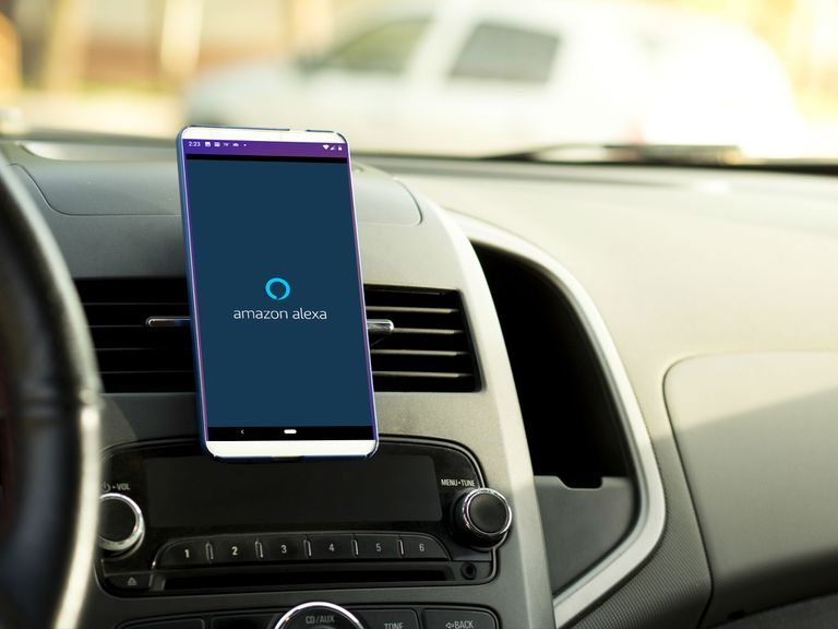 A phone mounted in a car displays Alexa.