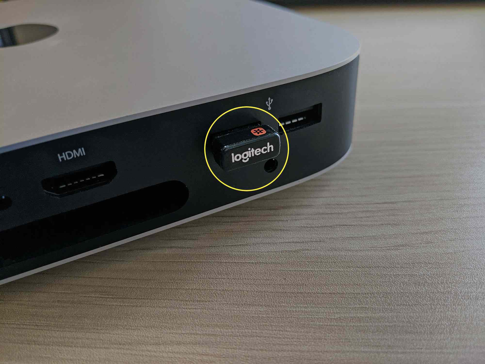 A Logitech Unifying receiver inserted into a Mac Mini.