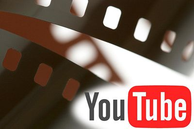 YouTube logo on an illustrated film strip background