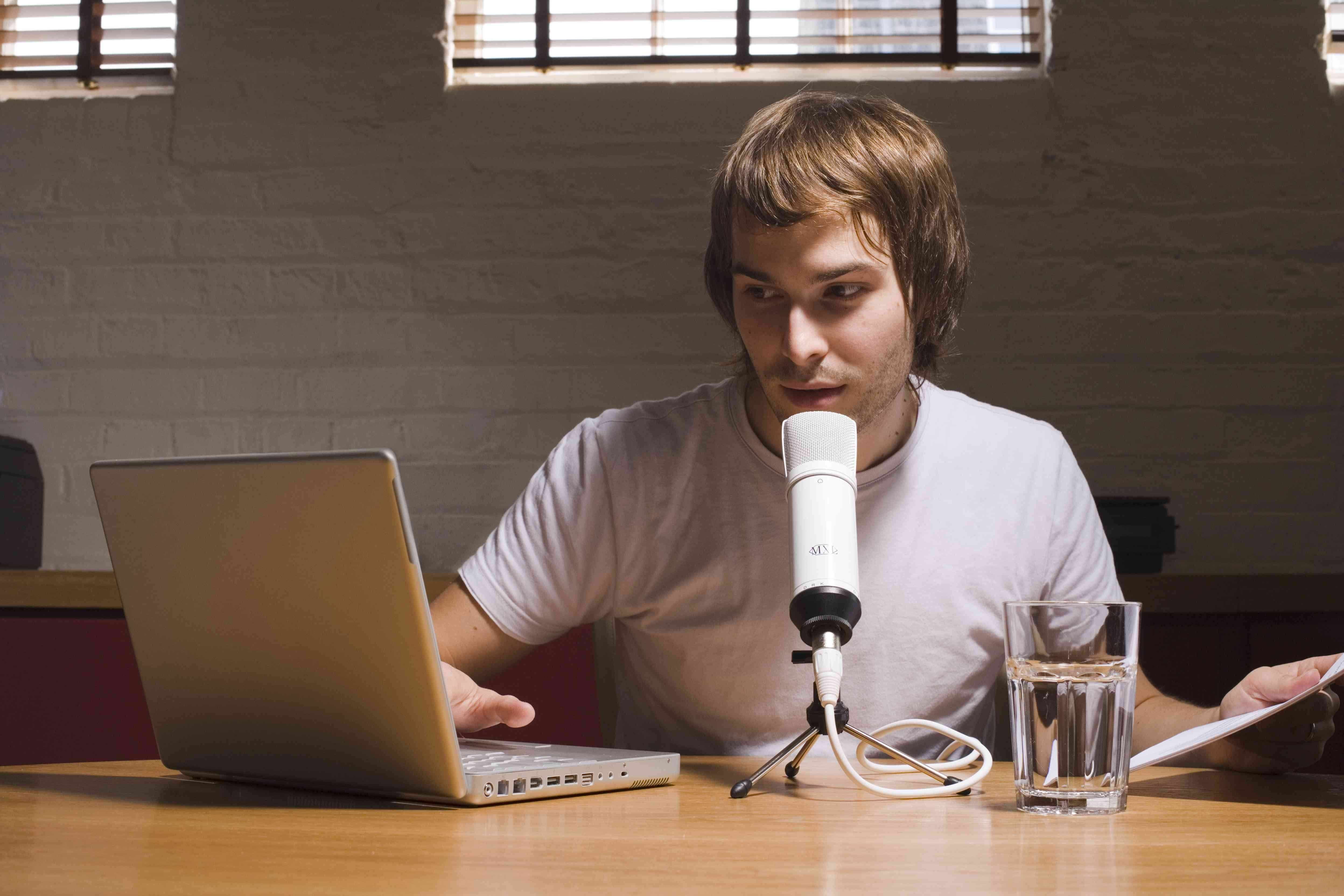 Person with laptop and microphone.