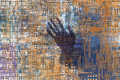A ghostly hand is seen within a complex network of computer circuitry representing a firewall