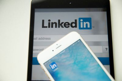 An image of LinkedIn on a tablet and a smartphone.