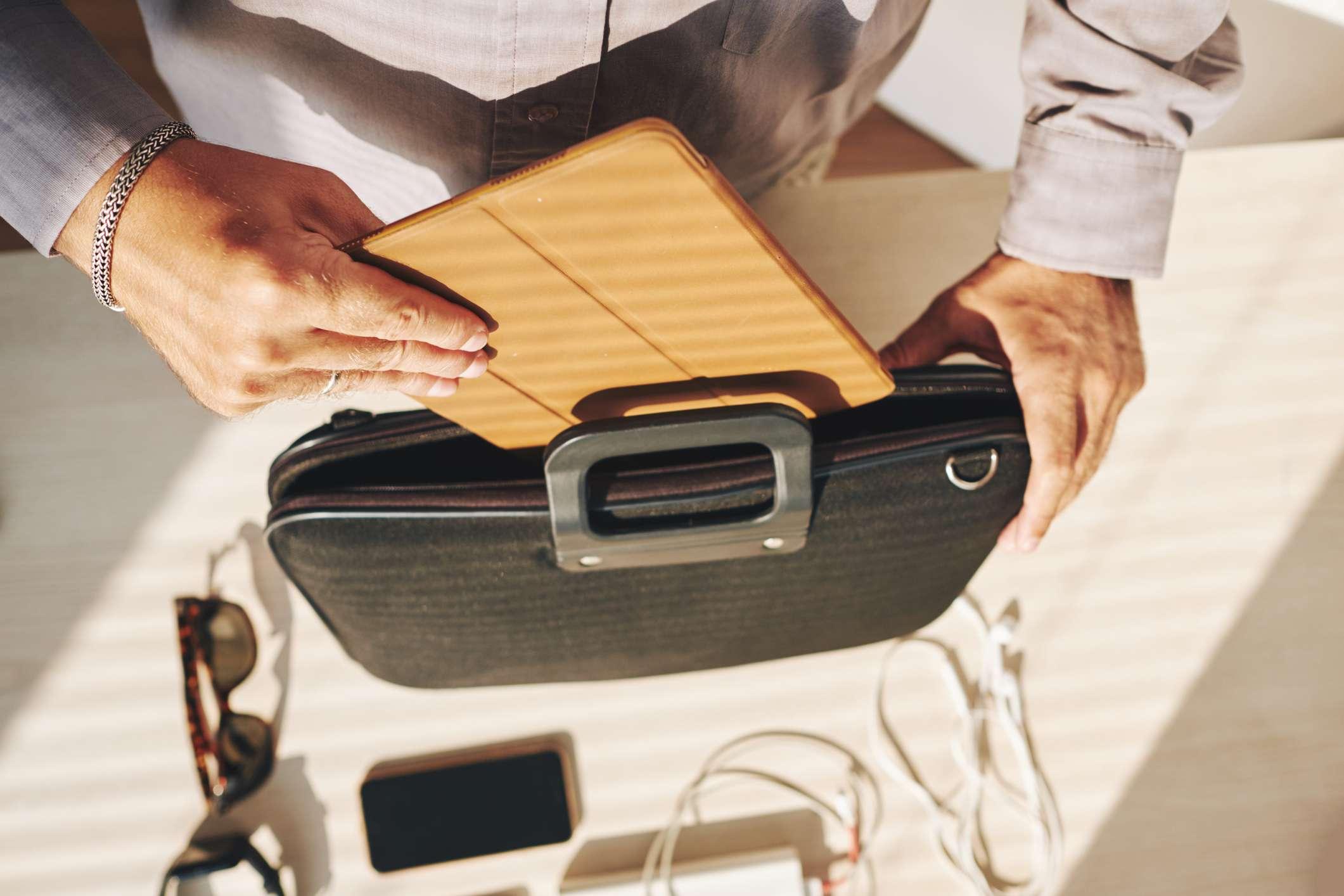iPad case being put in a briefcase