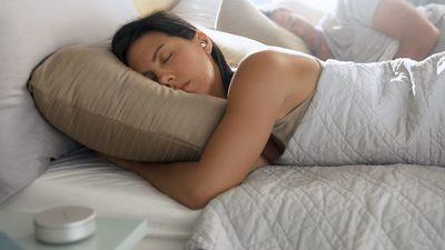 Woman sleeping wearing Bose headphones