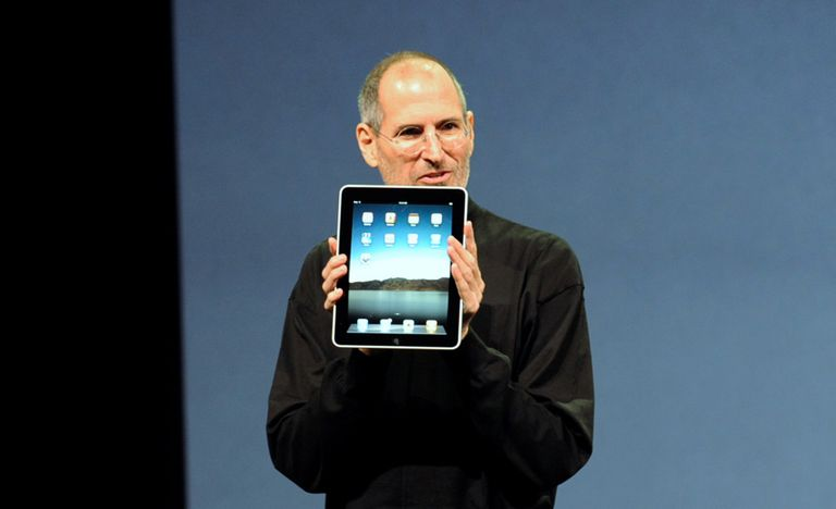 Steve Jobs holding up the original iPad in 2010