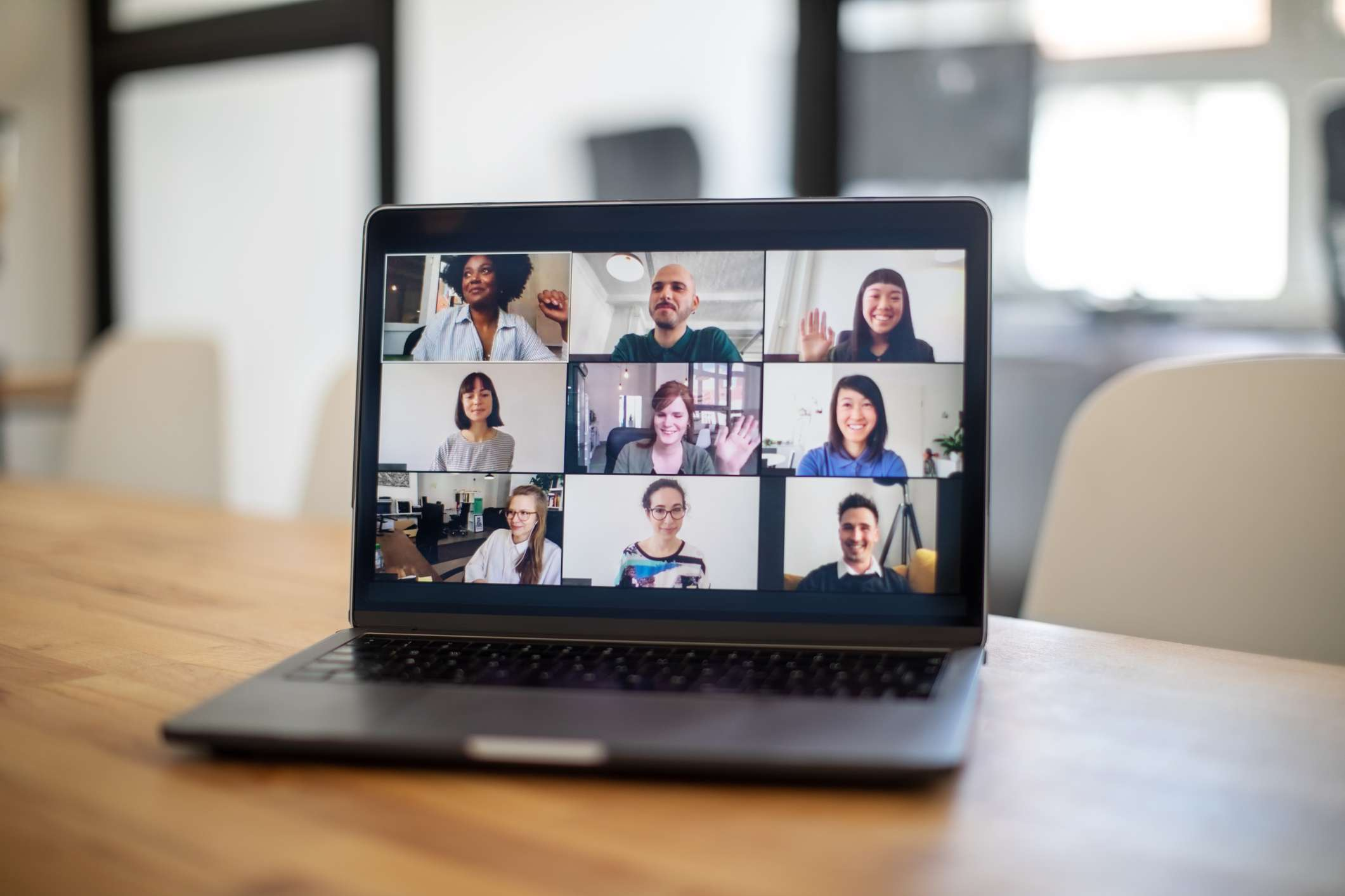 Group of business people seen on a laptop screen having an online meeting.