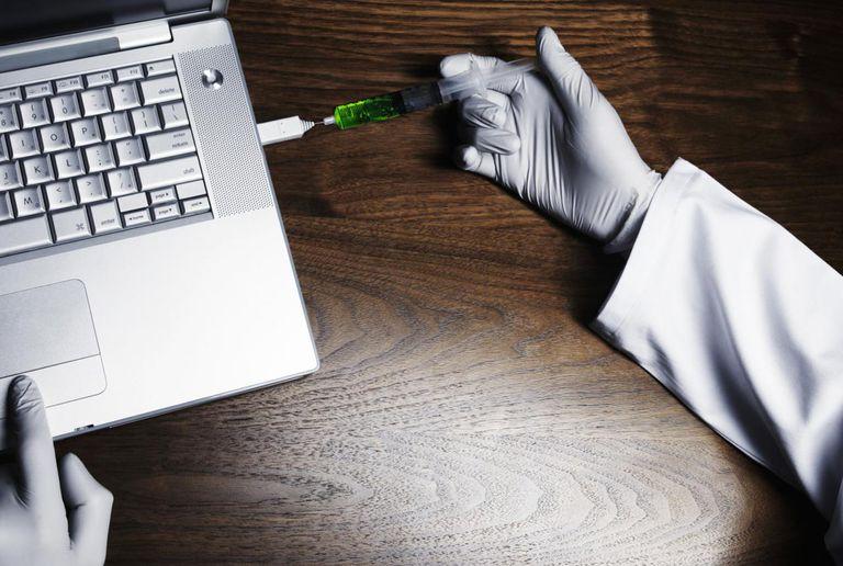 Doctor repairs laptop