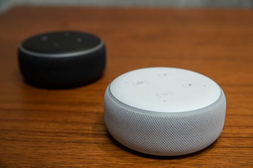 Amazon Dot devices on a table