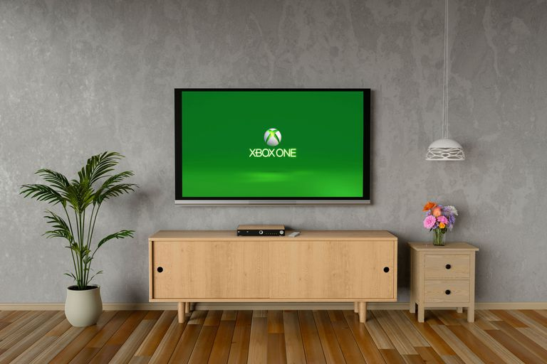 A television displaying the Xbox One stuck loading screen after a failed update.