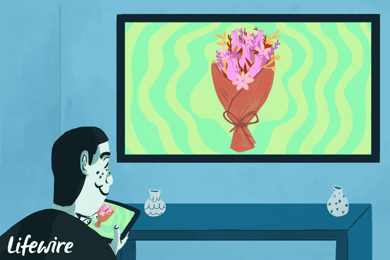 A person mirroring a display of flowers from their iPad to a big screen tv