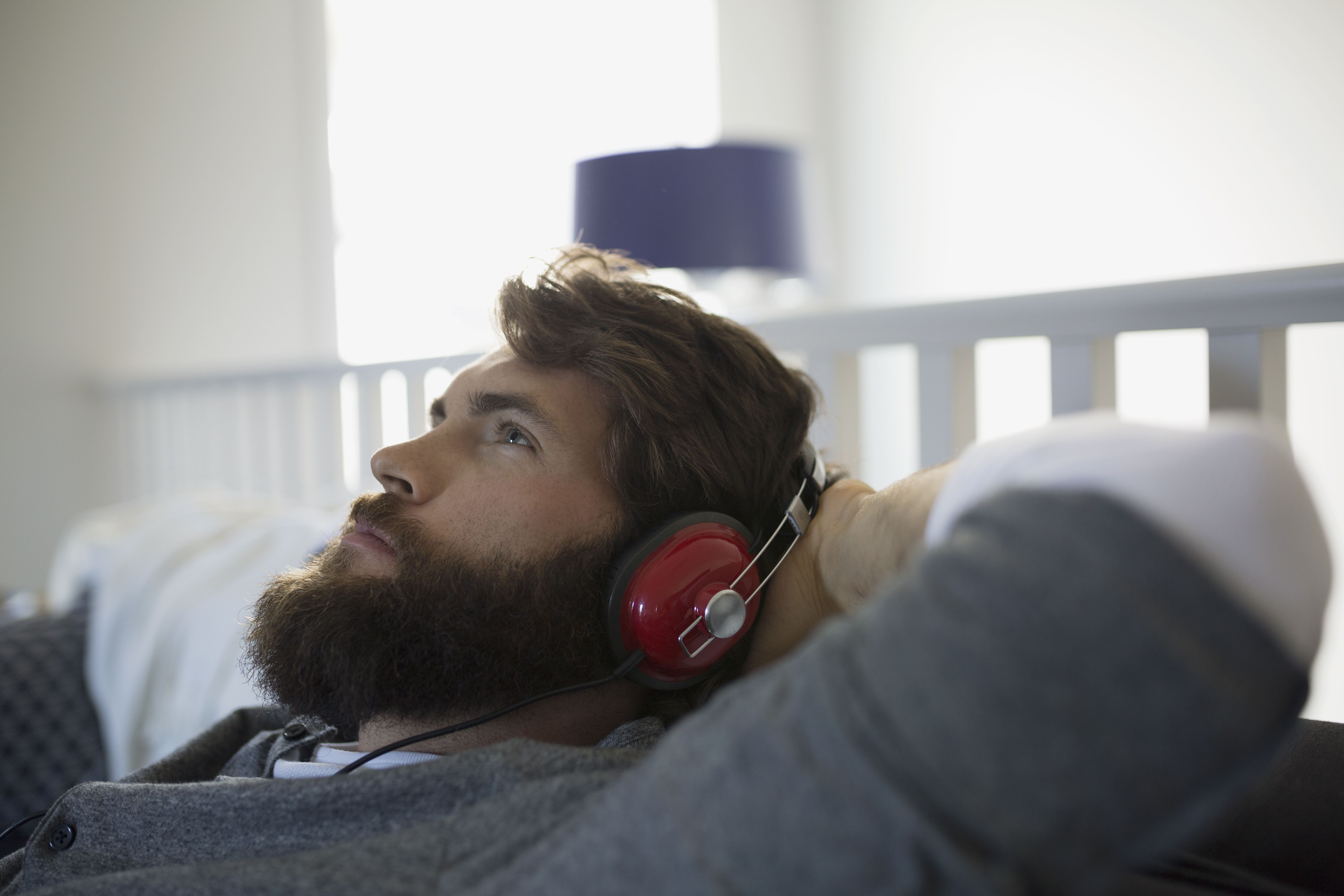 Man with headphones relaxing listening to audiobooks