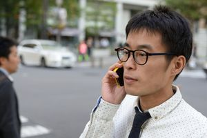 Man in street talking on phone