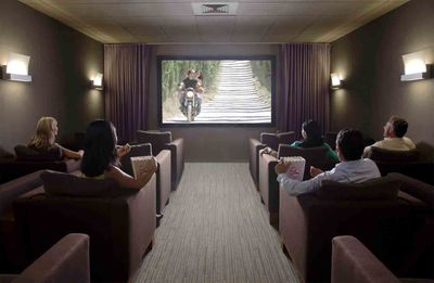 Group watching movies in a home theatre