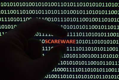 The word SCAREWARE is isolated in an image of ones and zeroes
