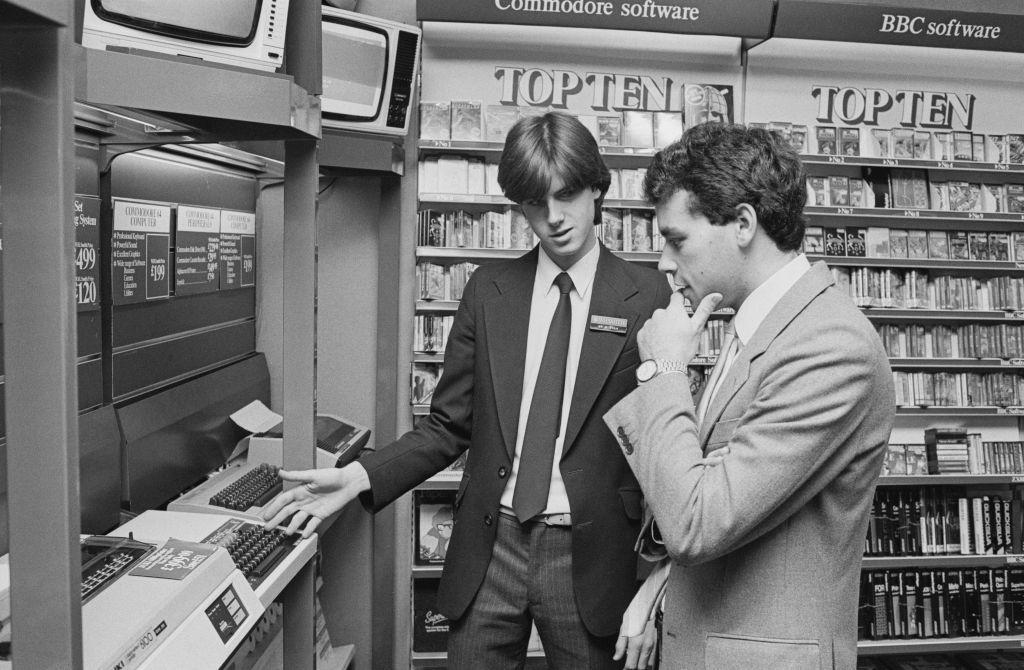 Salesman explaining Commodore 64 to customer