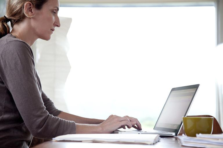 Woman using laptop in an office.