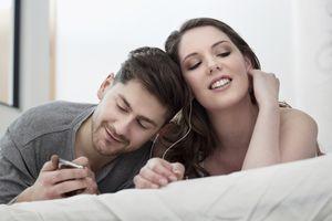 Couple listening to music on an iPod Touch