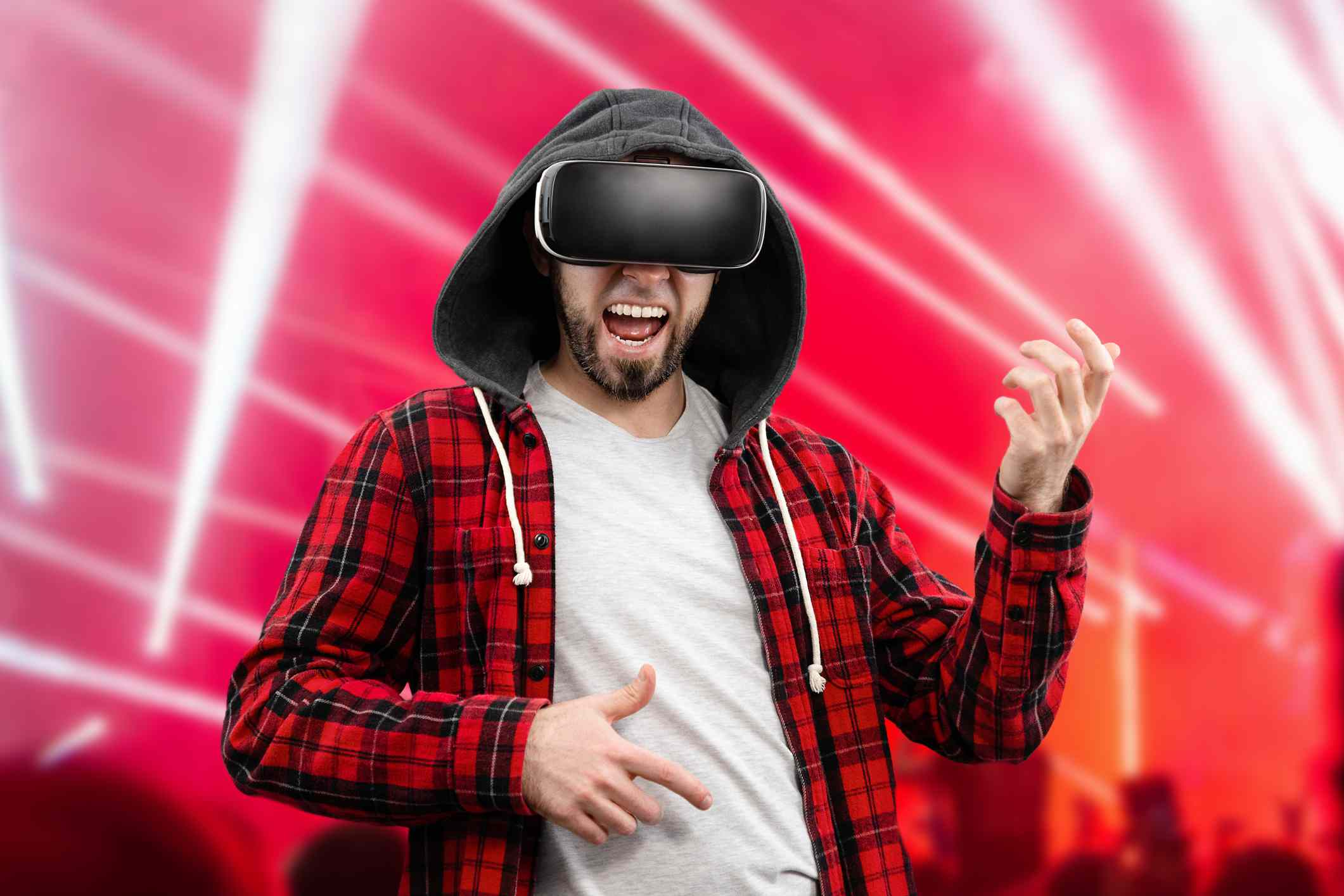 Someone attending a VR concert and playing air guitar.