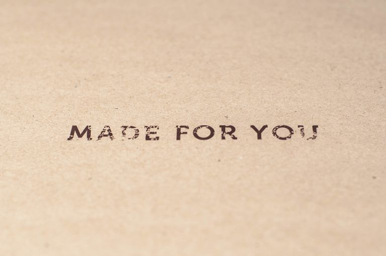 "A ""made for you"" sign written on a brown paper - stock photo"
