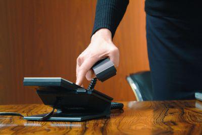A businessman using a VoIP phone