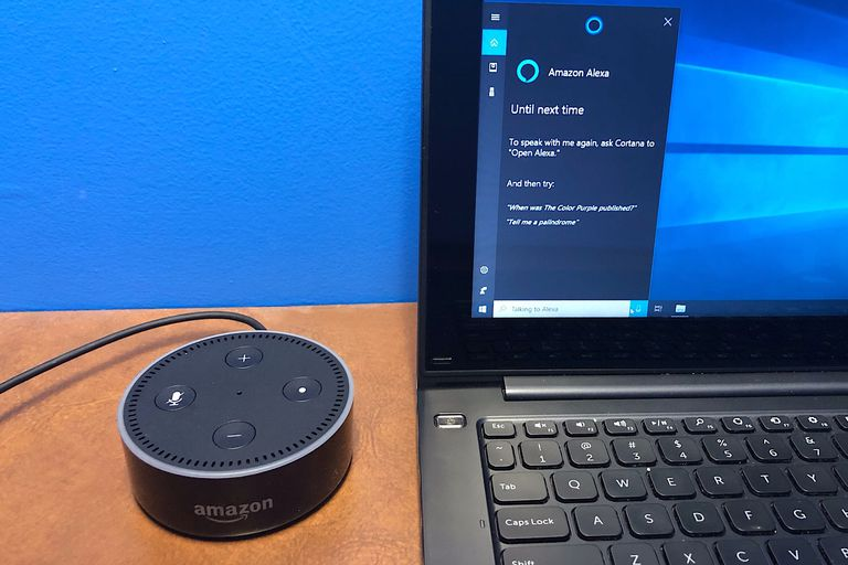 Photo of Amazon Echo Dot next to Cortana open with the Alexa skill on a Windows 10 system.