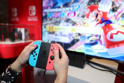 A photo of someone playing Mario Kart 8 Deluxe on Nintendo Switch