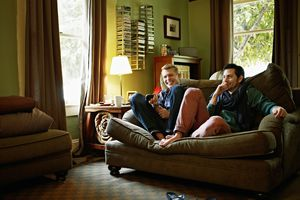 Couple sitting on couch in home watching TV