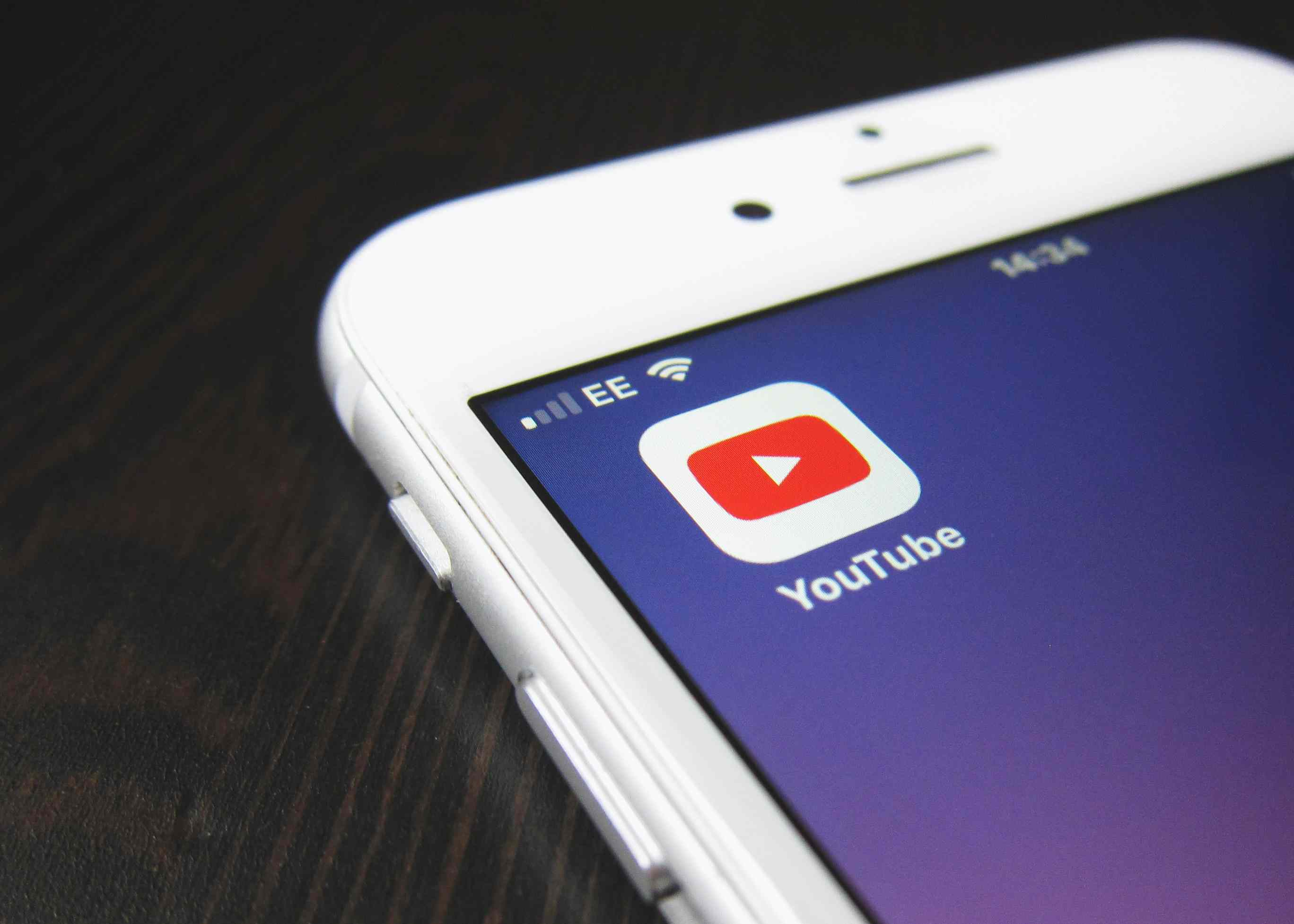 Closeup of the YouTube icon on a smartphone.