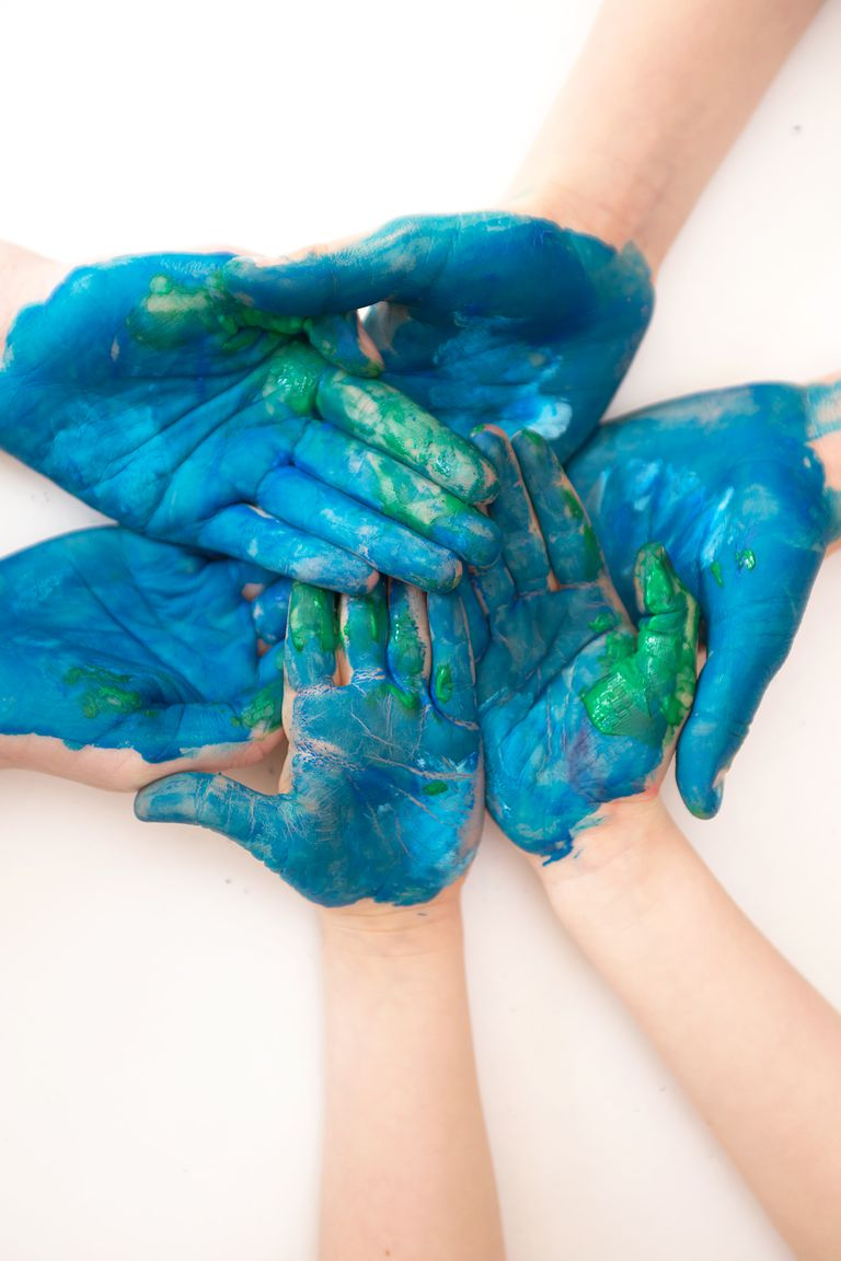 Hands with earth-style paint on them