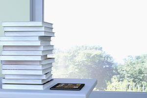 E-reader and stack of book lying on a table in front of a window, 3D Rendering