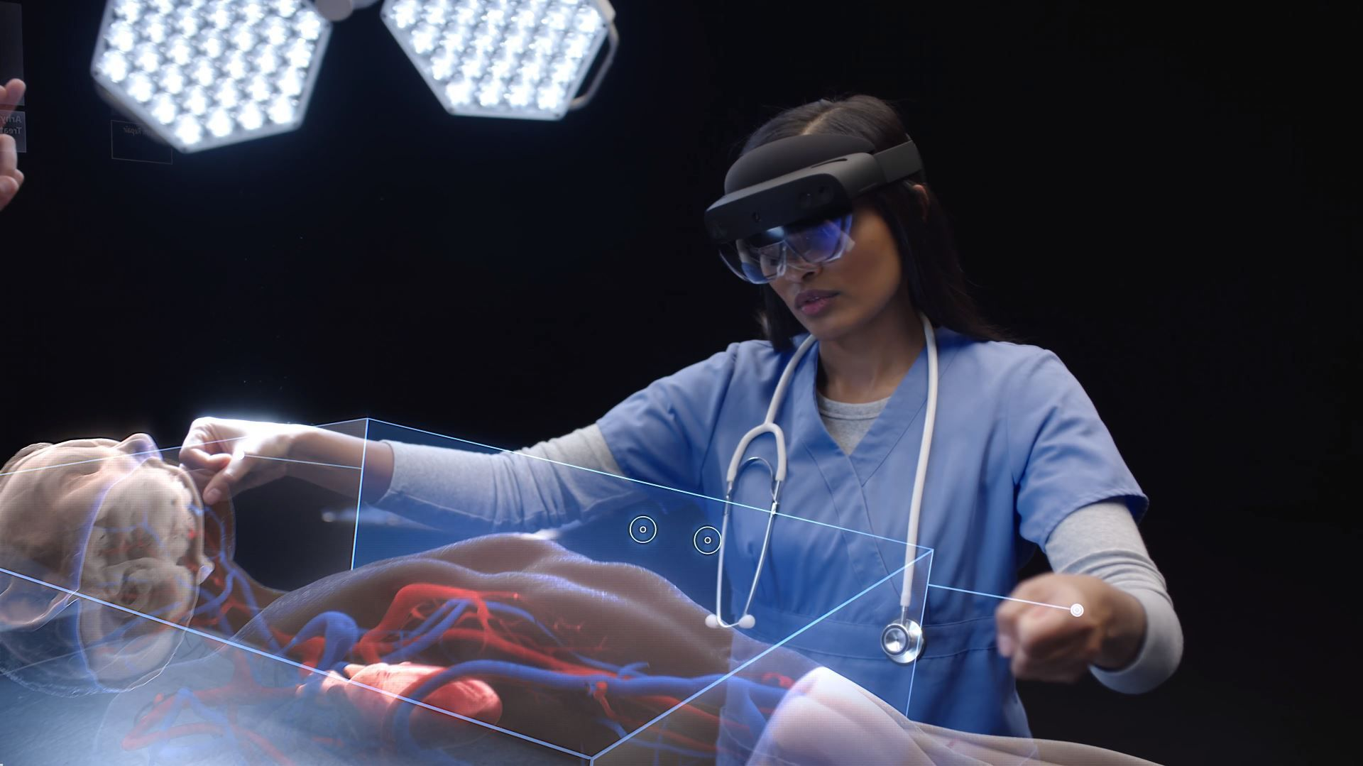 A doctor uses HoloLens 2 to visualize a patient's circulatory system.