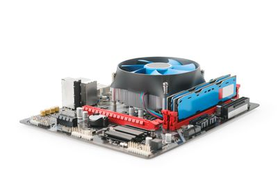 CPU on motherboard with large cooling fan