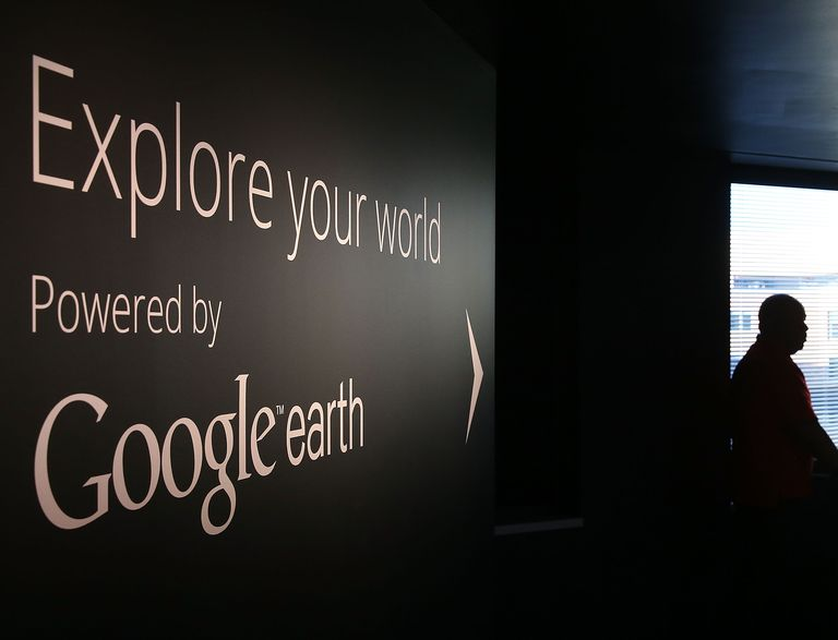 A man stands near a Google Earth exhibit at Google's Washington headquarters