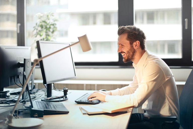 A man using a computer at a desk.