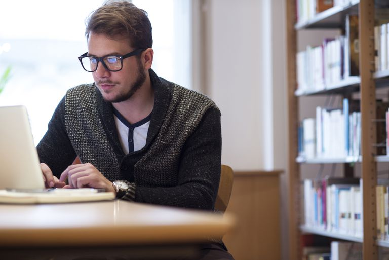 Young man in library