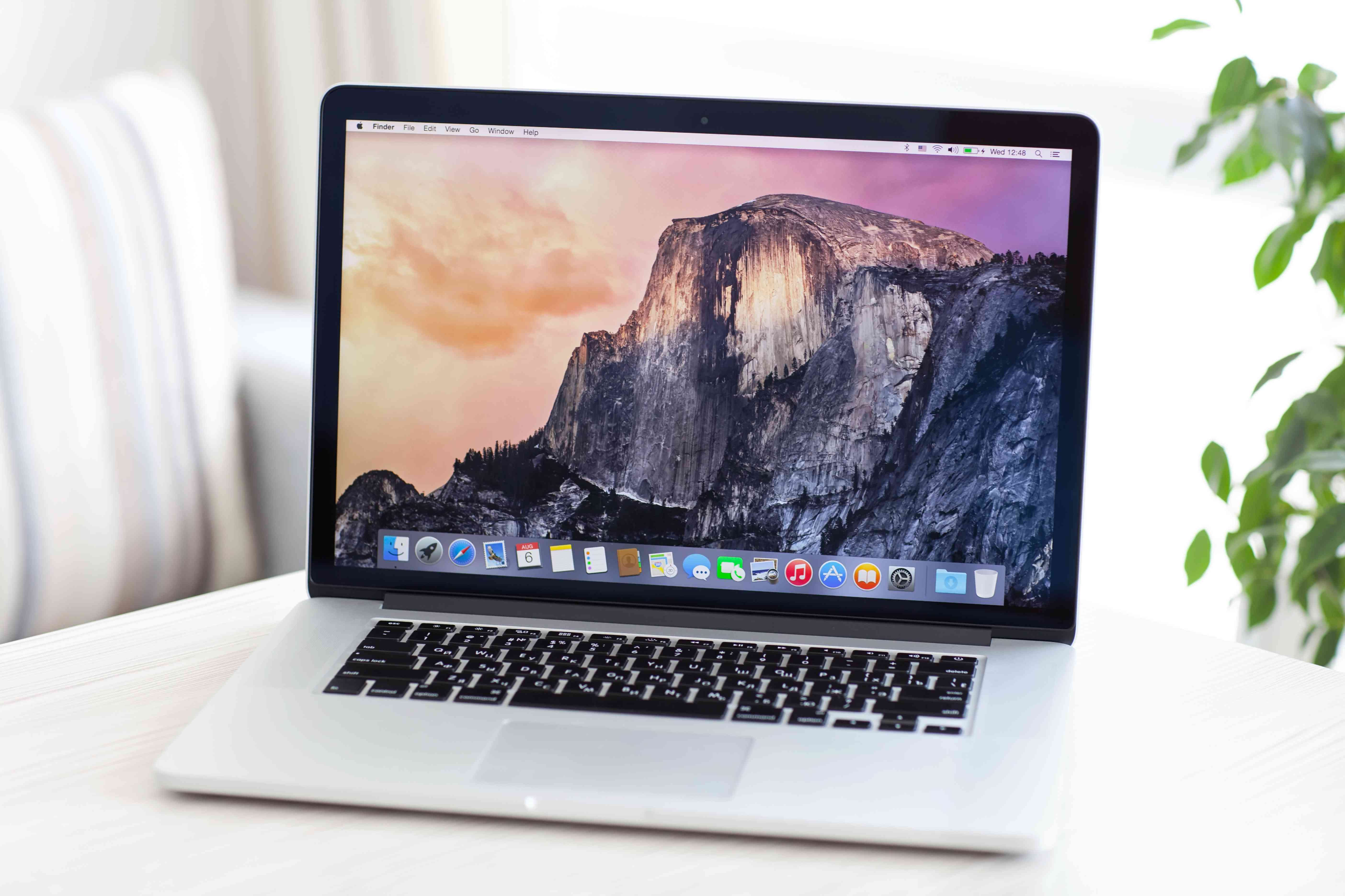 Apple laptop on white table