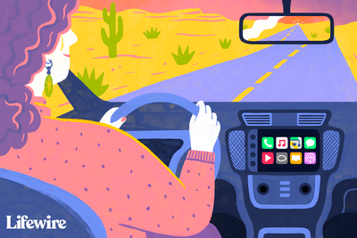 Person driving a car with CarPlay enabled