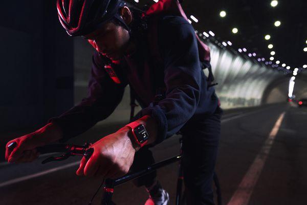 Apple Watch Series 7 worn by a bike rider