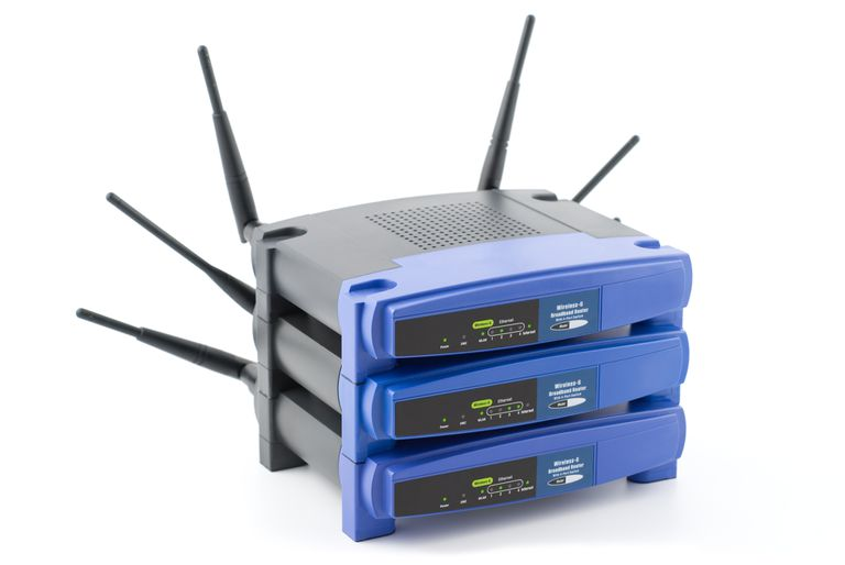 3 Linksys routers stacked on each other
