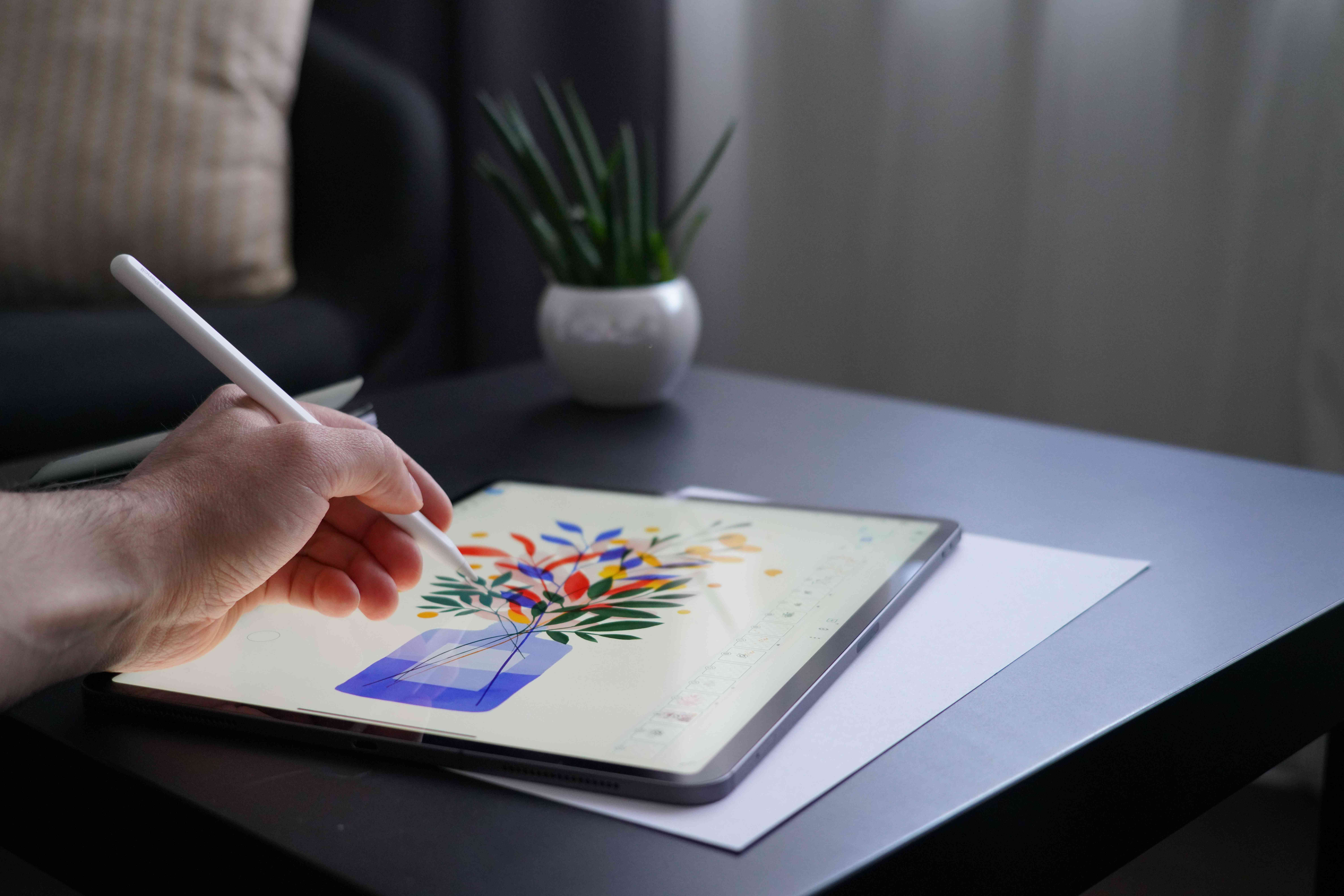 Someone creating an illustration on an iPad Pro.