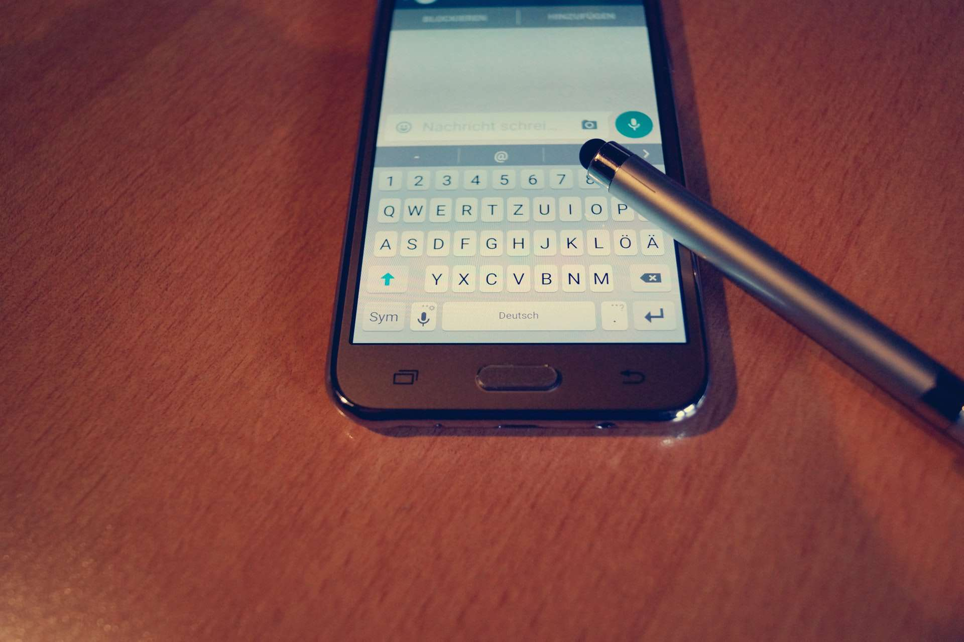 A smartphone and stylus.