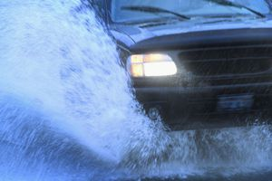A vehicle with traction control driving on a slick surface.