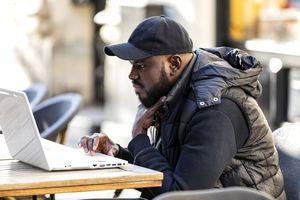 Man on laptop searching