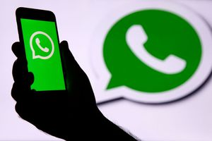 the WhatsApp logo is displayed on the screen of an iPhone in front of a TV screen displaying the WhatsApp logo on December 10, 2019 in Paris, France
