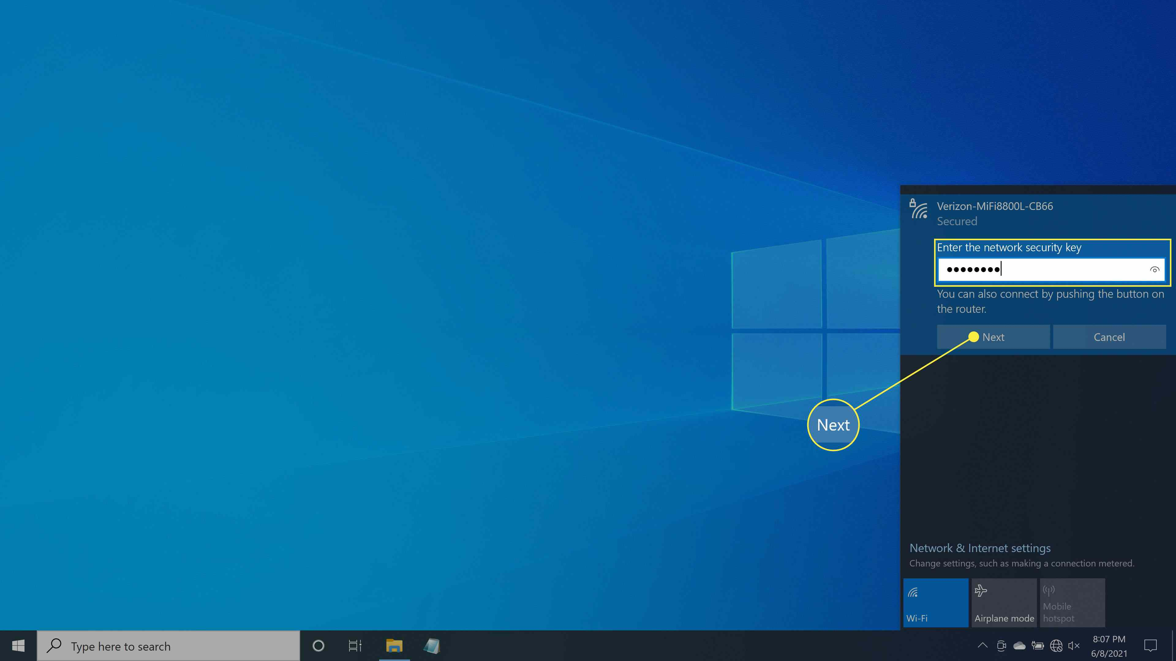 Entering in a network key and selecting Next to continue wireless connection setup in Windows 10.