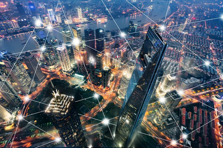 Illustration of a city's wireless network over a cityscape at night