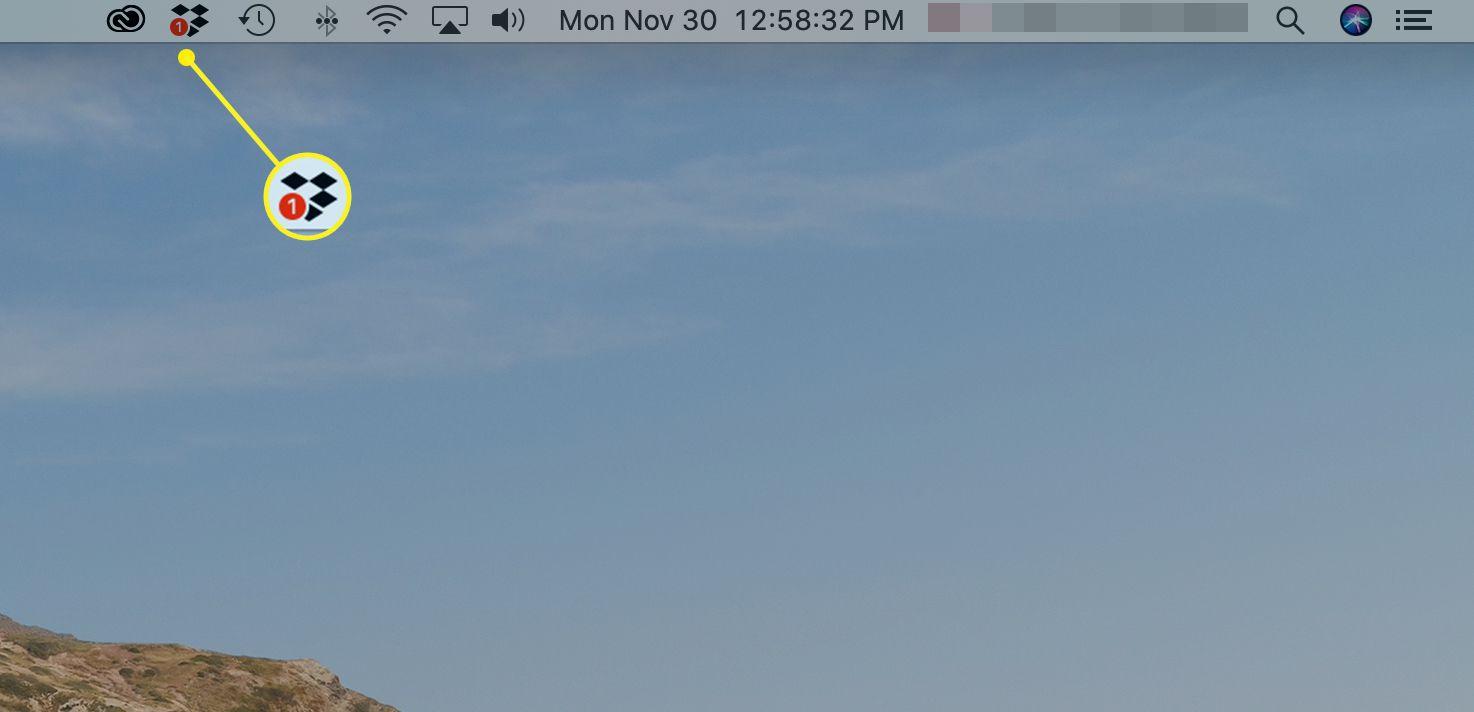 Mac desktop showing Dropbox logo in menu bar