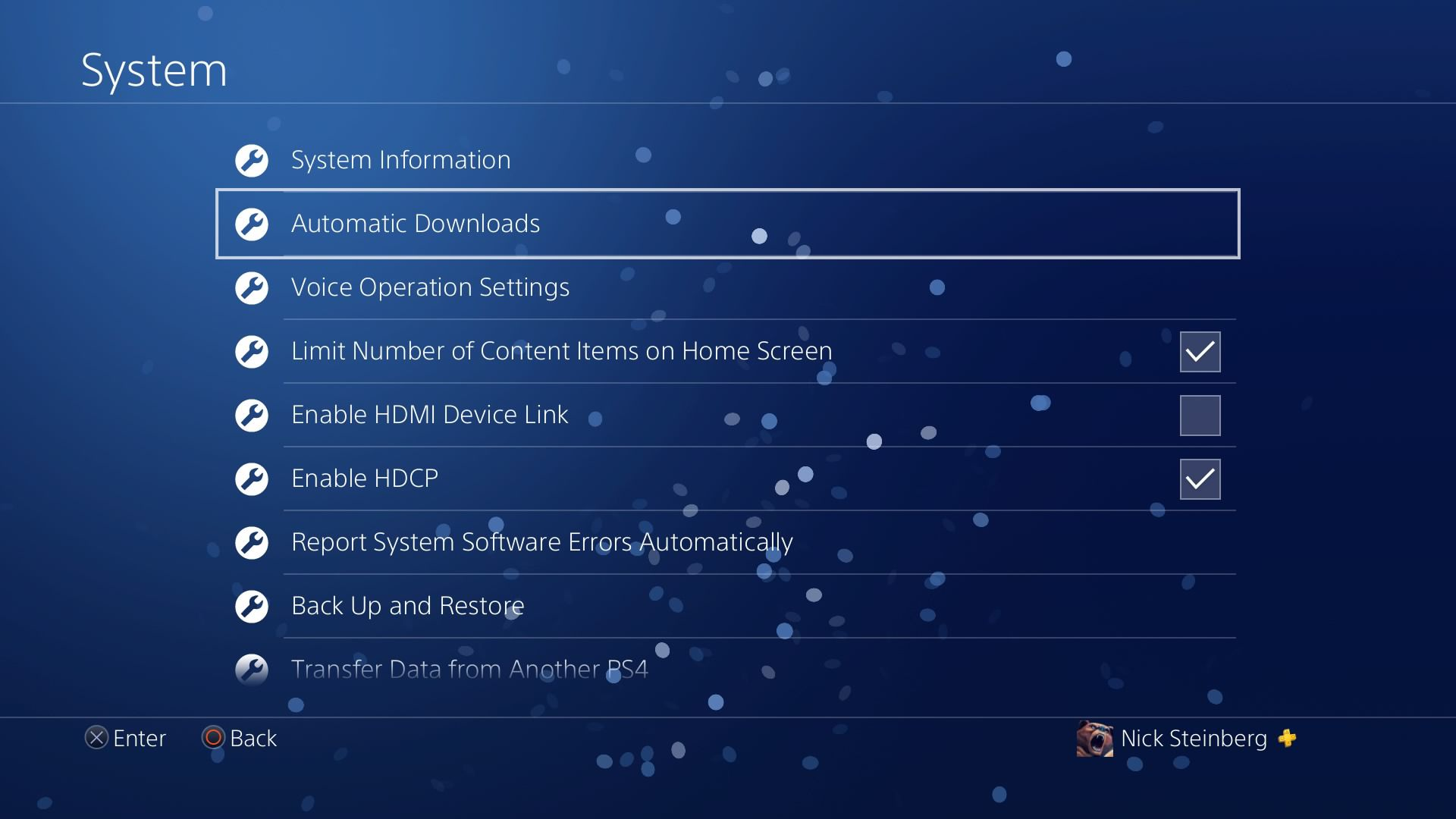 Selecting Automatic Downloads under PS4 System Settings.