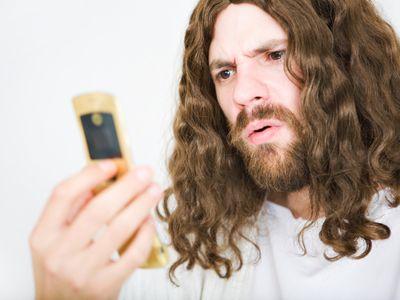 Jesus using a flip phone